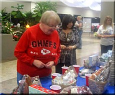 Joyce Kempf at raffle table
